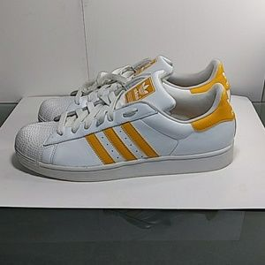 Men's size 13 yellow and white Adidas shell tops